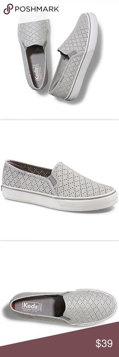 """New Keds Double Decker slip on An updated classic, Keds' Double Decker sneakers feature a perforated design that brings lace-like femininity to relaxed, casual style. Runs true to size Round closed-toe slip-on flat sneakers Perforated upper Elastic goring for easy slip on entry 1"""" platform Fabric upper; manmade sole Soft, breathable lining, cushioning insole Flexible textured rubber outsole Keds Shoes Sneakers"""