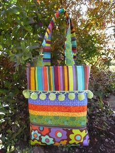 awesome cute bag with ball fringe trim tutorial.  she has a gob of other tuts too.