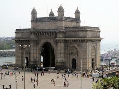 India, Mumbai. This photo was taken from our hotel room. The Gateway of India is a monument built during the British Raj in Mumbai, India. It is located on the waterfront in the Apollo Bunder area in South Mumbai and overlooks the Arabian Sea. The structure is a basalt arch, 26 metres high.