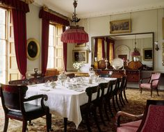 The Dining Room, The Argory. The table is set with family china & silver for tea, traditionally the family's occasion for entertaining. Northern Ireland.