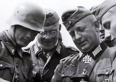 German and Hungarian officers confer on the battle plan, Eastern Front, summer 1941. The Hungarians were reluctant allies to the end. Note the Hungarian lieutenant on the left wearing standard German service helmet.