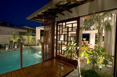 Chris Clout Design tropical resort style modern house in Noosawaters with winning pool lighting interiors and landscaping Japan home entry