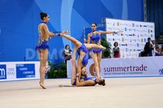 United States's team performing the clubs routine during the FIG Rhythmic Gymnastic World Cup series Pesaro 2014.