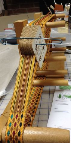 tablet inkle weaving, love the use of the cable stitch holder to keep the cards tidy and in place.