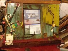 Junk art picture frame from old barn wood and hinges