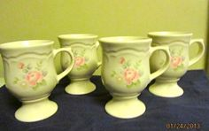'Pfaltzgraff tea rose pedestal mugs lot of 4' is going up for auction at  6pm Wed, Jan 30 with a starting bid of $12.