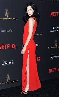 Krysten Ritter stunned in a red dress by Osman with an Emm Kuo clutch. See more Golden Globes afterparty looks here!