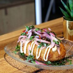 Dig into some comforting dishes like Peruvian papa rellena  silky potato stuffed with beef served with salsa criolla @elatino_co