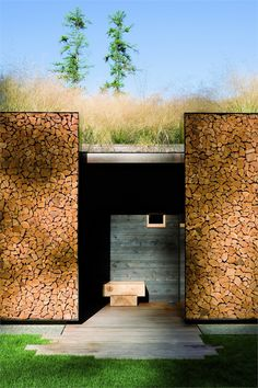Andersson-Wise Architects - not a cargo container, but similar shapes. Perhaps the  cordwood home design could be combined with shipping container?