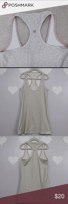 Lululemon Beige Stretch Knit Racer Back Workout Excellent condition with no stains nor holes. This tank does NOT have built in bra nor lining.  NO size label, please use measurement below.  Measurements taken flat (might be off couple inches) Length: 26.5 Armpit across: 13.5  Material: polyester and lycra spandex. lululemon athletica Tops