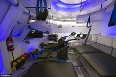 The Boeing capsule, interior view of a prototype pictured, will be able to seat a crew of ...