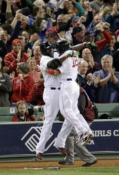 Boston Red Sox's Shane Victorino, right, celebrates his grand slam with David Ortiz in the seventh inning during Game 6 of the American Leag...