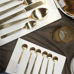 I wanted this so hard for our registry and got vetoed. Still longing for it (who knew i could feel that way about flatware??)   Matte Gold Flatware from Canvas NY Now Gift Fair