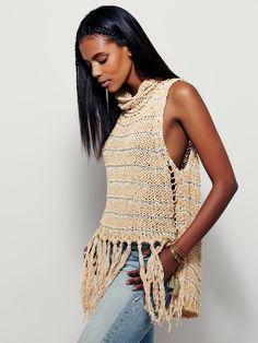 Folksong Fringe Vest | Semi sheer loose knit vest featuring a cowl neckline and exaggerated fringe detailing at the front with a high-low hemline. Dropped armholes and an oversized silhouette.