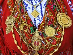 Bring on the bling. Elaborate embroidery and gold necklaces are traditional elements of thelavradeirafolk costume in Portugal. Today's Travel 365» Photograph by Mauricio Abreu, JAI/Corbis