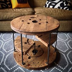 Salvaged cable spool coffee table with floating shelves by 22bd Supply Co…