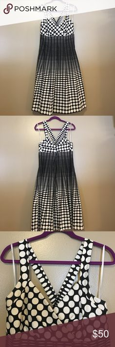 Dana Buchman Dress Black and White patterned Dana Buchman Dress, cross back design with back zipper, size 14, lightly pleated to a loose fitting bottom, v-neck, never worn, perfect condition Dana Buchman Dresses Midi