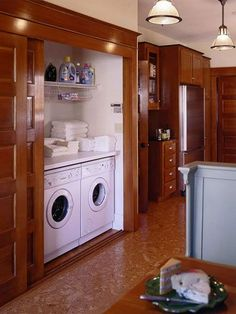 Laundry in kitchen ideas.     Hide Laundry with Sliding Doors