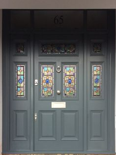 A large Victorian front door with bespoke leaded light