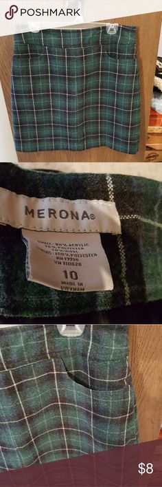 Green Plaid Skirt Wool plaid skirt. Straight with back zipper closure. Pockets in the front. Falls a couple inches above the knee. Excellent used condition. Merona Skirts Midi
