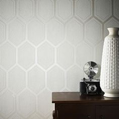 Chamonix is a great large scale geometric wallpaper design with an added pearlescent shine in the main body of the pattern. A really bold design in this subtle color pallette will make a really stylish impact in any room of any home.  Graham