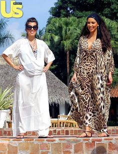 A six-months-pregnant Kourtney covered up her bump in a white robe while out with sis Kim.