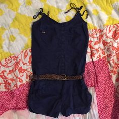 Button up romper Adorable romper! Only worn a few times. The top part has buttons and the bottom part has pockets. The straps at the top tie too and have little beads on them. The romper originally came with a different belt but I forgot where I put it so I included one but it is worn!! mandee Other