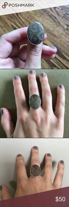 925 sterling silver coral fossil artisan ring Obsidian brand. Stone is 1 inch in length. Adjustable band. It's set at 6.5 now but can move up or down a bit from that. 925 Sterling Silver Coral Fossil Sunburst Ring with thick Adjustable sterling band. obsidian Jewelry Rings