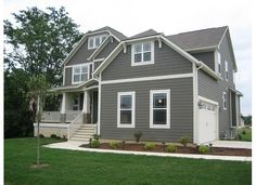 I love this! Crisp white trim, greeny-grey siding and shingles in the same colour.