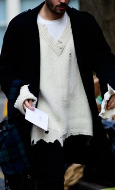 Raf Simons is a master of the oversized silhouette. Case in point, this bigger is better knit from FW16. Street Style.