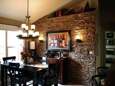 Stone wall in kitchen modern interior design medium size interior stone accent wall faux panels brick . stone wall in kitchen Hearth Tiles, Stone Accent Walls, Faux Panels, Brick Paneling, Freestanding Fireplace, Manufactured Stone, Fireplace Design, Fireplace Ideas, Dining Room Design