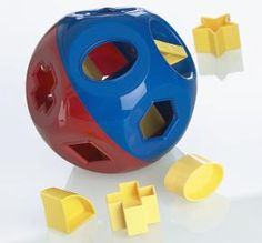 Tupperware Shape-O Ball: Classic rattle, shape-sorter and counting toy!  Easy for even infants to grasp.  Toddlers can use the 10 pieces to match the shapes on the toy, and develop coordination and dexterity. Each piece  has a number on one side with the corresponding number of dots on the other to teach preschoolers number recognition and counting. Shaped pieces store inside the ball to keep them from getting lost. Two handles are easy to grip and pull apart. #Toy #Shape_Sorter