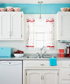 white cabinets, turquoise walls, red accents