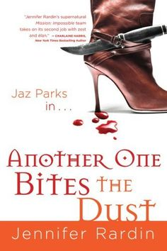 Another One Bites the Dust (Jaz Parks, Book 2) by Jennifer Rardin, http://www.amazon.com/dp/B001Q3M5MQ/ref=cm_sw_r_pi_dp_cw9Xpb0SZNWYT
