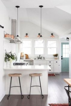 small kitchen design // white kitchen // light blue door // dark hardware // gla… - All For Decoration Beach Kitchen Decor, Beach Kitchens, Beach House Decor, Diy Kitchen, Kitchen Cabinets, Kitchen Hacks, White Kitchens, Kitchen Layout, Beach Houses