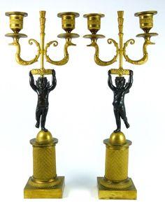 "Pair of French gilt bronze putti cherub figural candelabras. Each measures 14"" (36cm) height by 6"" (15cm) widt"