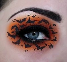 Awsome Halloween eye makeup with orange eye shadow thick eye liner and then using the eye liner to make the bats , crazy genius