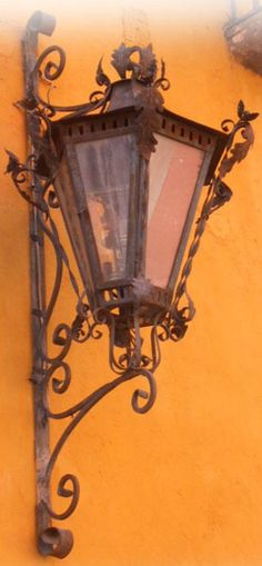 This victorian outdoor wall lantern was hand crafted of hammered iron. The lantern is available with oxidized finishing, unfinished or painted black. Outdoor Wall Lantern, Outdoor Walls, Candle Sconces, Wall Sconces, Rustic Wall Lighting, Iron Wall, Metal Tins, Ceiling Lamp, Lanterns
