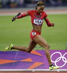 Day 15 - USA's Sanya Richards-Ross heads to the finish line to win the gold medal in the women's 4x400-meter during the athletics in the Olympic Stadium at the 2012 Summer Olympics, London, Saturday, Aug. 11, 2012. (AP Photo/Matt Slocum)