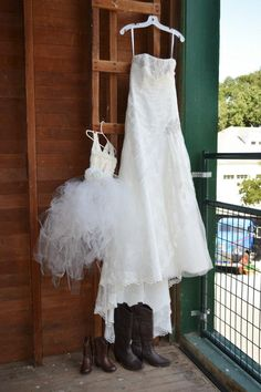 Brides dress and flower girl dress, both hung in the upstairs barn.