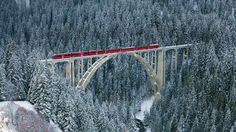 Rhaetian railway passing through Langwieser Viaduct bridge, Switzerland