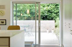 3 pane smarts 1000 system folding door duration and express type & ViewPoint Vinyl Windows \u0026 Doors by Norandex | Living room ...