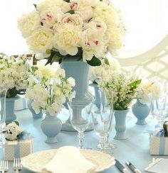 {Fluffy peonies, delphinium, and lily of the valley in classic pale blue vases (love the blue linens in this as well!) – photo by Carolyne Roehm via Brabourne Farm and The Sweetest Occasion}