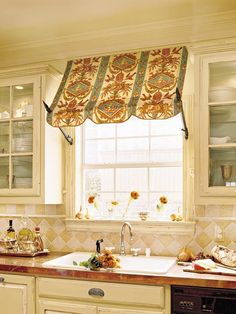 A fabric awning accents the window above the sink. This gives the space dimension & the ambiance of a sidewalk café.