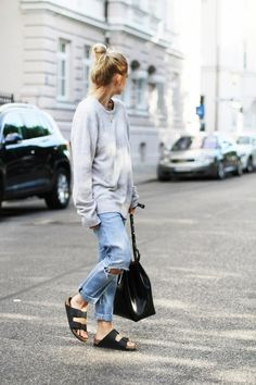 Shop this look for $60:  http://lookastic.com/women/looks/grey-oversized-sweater-and-light-blue-boyfriend-jeans-and-black-tote-bag-and-black-flat-sandals/3082  — Grey Oversized Sweater  — Light Blue Ripped Boyfriend Jeans  — Black Leather Tote Bag  — Black Leather Flat Sandals