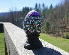Beautiful hand-painted dot mandala wooden Egg with stand. Perfect for Easter!!! Egg and pedestal stand are made of high-quality solid wood. *Painted with acrylic paint and sealed.  Egg Size: ~2.5 Tall; ~1.75 center horizontally Stand Size: ~1.25 Tall; 1.75 bottom horizontally  Your egg will be boxed and ship Insured via USPS Priority Mail (2-3 days.)  ***Thank you for looking and have a beautiful day***  Follow me on Instagram for Sale Announcements and Coupon Codes: @la_bella_artigiana  Go…