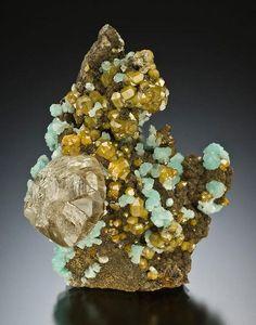 ~ Cerussite, hemimorphite, and mimetite on willemite. Republic of the Congo.  Jeff Scovil photo