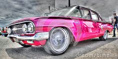 A custom painted pink Bel Aire on display at car show