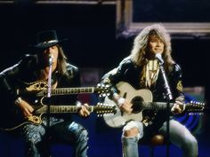 LOS ANGELES - SEPTEMBER 6:  Jon Bon Jovi and Richie Sambora perform an acoustic version of Wanted Dead Or Alive at the 6th Annual MTV Video Music Awards at the Universal Amphitheatre on September 6 1989 in Los Angeles, California. (Photo by Michael Ochs Archives/Getty Images)