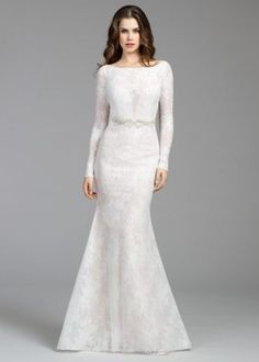 Tara Keely 2653 Ivory Chantilly lace and mesh sheath bridal gown, cashmere underlay and bateau neckline, deep sweetheart bodice with belt at natural waist, long sleeves with button detail, keyhole back with thin encrusted strap and chapel train.